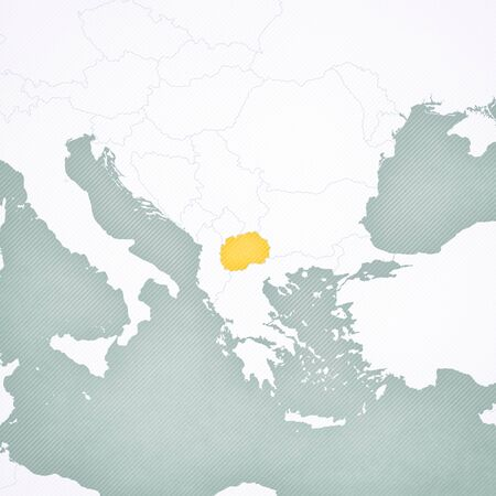Macedonia on the map of Balkans with softly striped vintage background.