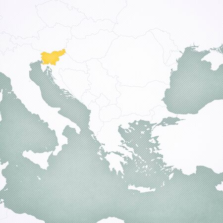 Slovenia on the map of Balkans with softly striped vintage background.