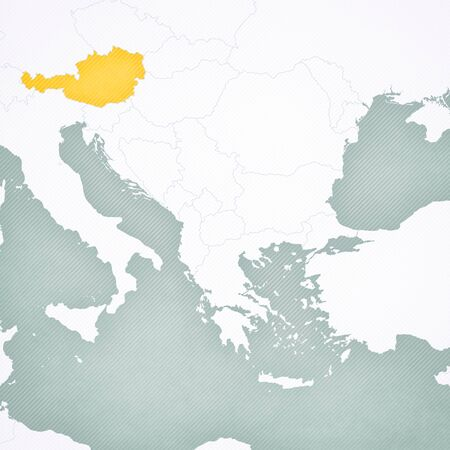 Austria on the map of Balkans with softly striped vintage background.