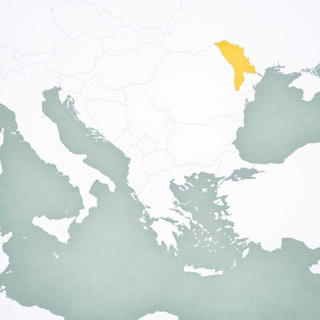 Moldova on the map of Balkans with softly striped vintage background.