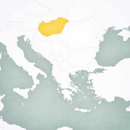 Hungary on the map of Balkans with softly striped vintage background.