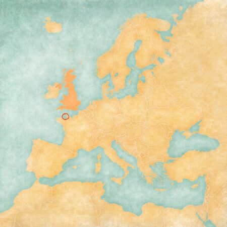Jersey with UK on the map of Europe in soft grunge and vintage style, like old paper with watercolor painting. Stock Photo