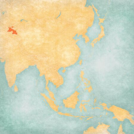 Tajikistan on the map of East and Southeast Asia in soft grunge and vintage style, like old paper with watercolor painting.