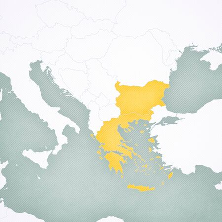 Greece and Bulgaria on the map of Balkans with softly striped vintage background. Imagens
