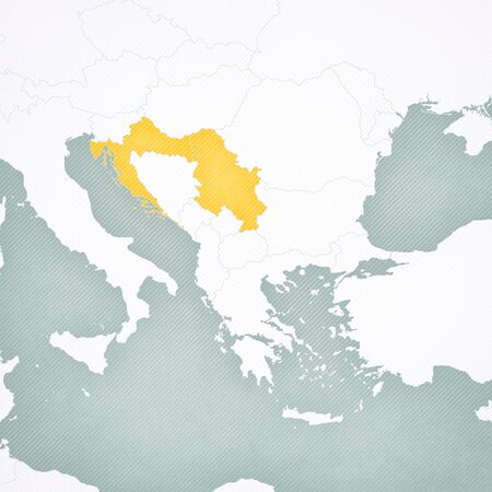 Serbia and Croatia on the map of Balkans with softly striped vintage background.