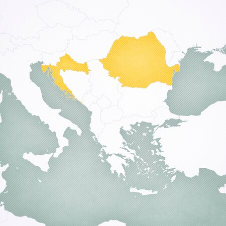 Romania and Croatia on the map of Balkans with softly striped vintage background.