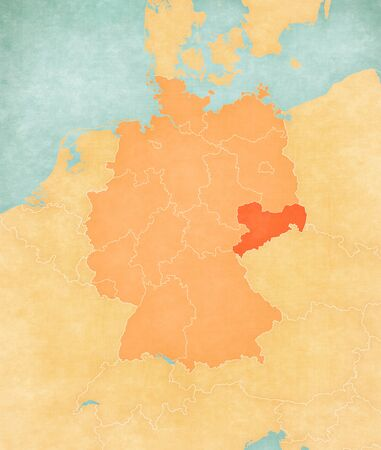 Saxony on the map of Germany in soft grunge and vintage style, like old paper with watercolor painting.