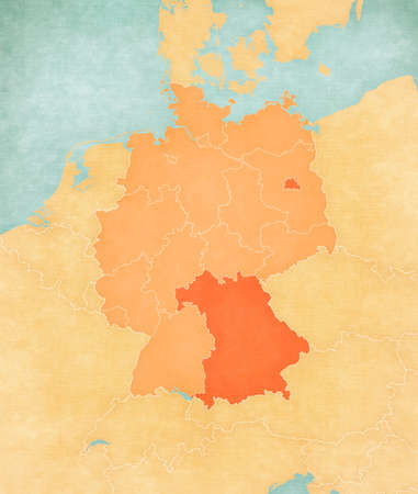 Bavaria and Berlin on the map of Germany (tan color) in soft grunge and vintage style, like old paper with watercolor painting. 版權商用圖片