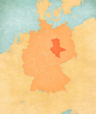 Saxony-Anhalt on the map of Germany (tan color) in soft grunge and vintage style, like old paper with watercolor painting. 版權商用圖片