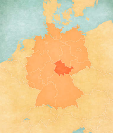 Thuringia on the map of Germany (tan color) in soft grunge and vintage style, like old paper with watercolor painting.