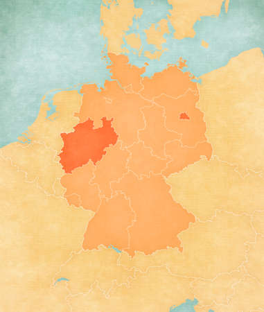 North Rhine-Westphalia and Berlin on the map of Germany (tan color) in soft grunge and vintage style, like old paper with watercolor painting. 版權商用圖片