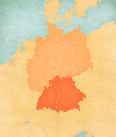Bavaria and Baden-Wurttemberg on the map of Germany (tan color) in soft grunge and vintage style, like old paper with watercolor painting.