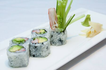 california maki sushi roll on white plate