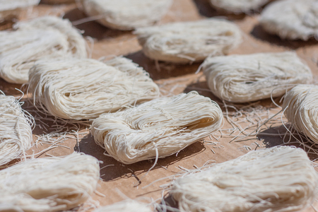 bunched: closeup of dry noodles drying in the sun Stock Photo