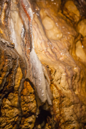 stalacites and stalagmites on cave walls