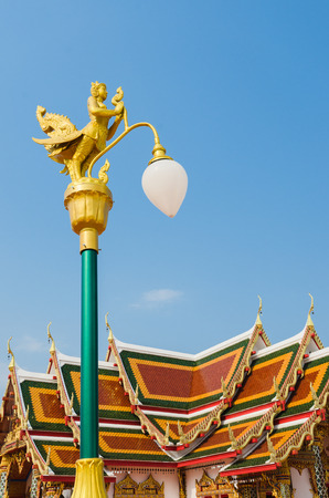 street lamp with the statue literature at  \\\wat Phra That Choeng Chum\\\  (named in Thai); the temple in Sakon Nakhon Province,Thailand photo