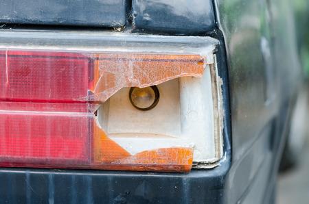 tail light: old car with broken car tail light