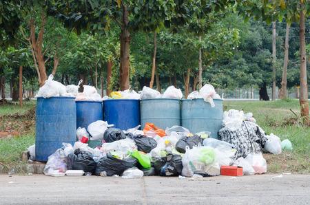 overfilled: Overflowing garbage bins