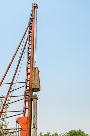precast: pile driver driving precast concrete pile on a construction site Stock Photo
