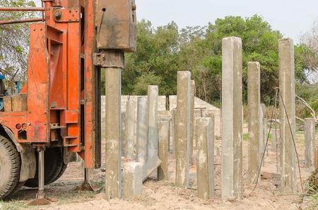 precast: pile driver driving precast concrete piles on a construction site
