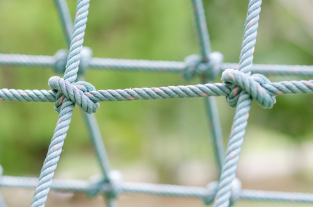 tied together: Close up image of climbing net for childrens at the playground.it tied together securely. Stock Photo