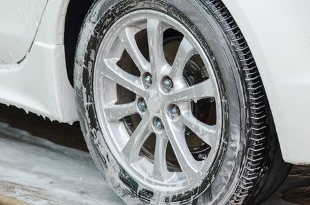 Foam on the wheels during car wash.