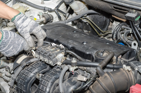 Auto mechanic repairing a car LPG system. Stock Photo