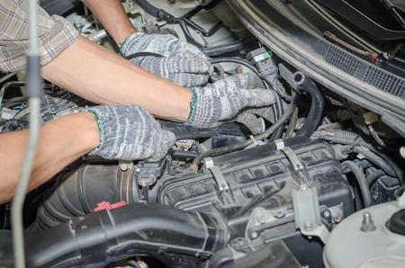 lpg: Auto mechanics repairing a car LPG system.