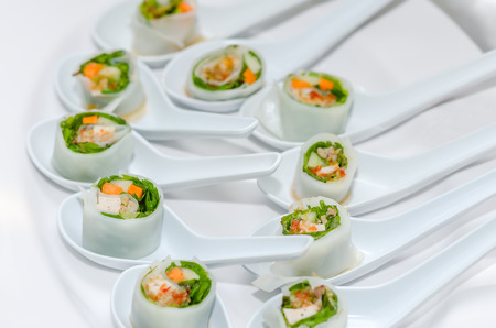 Delicious vietnamese spring roll with herbs.
