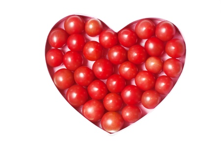 Red heart made with tomatoes photo