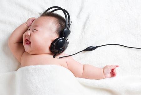 Cute baby listening to music, dancing  photo
