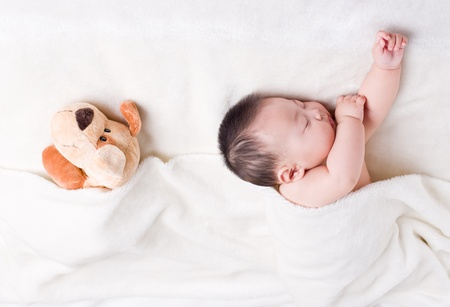 baby sleeping: Baby sleeping next to his favorite toy  Stock Photo