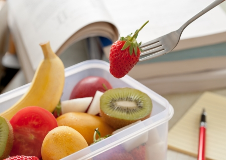 Complementary fruit nutrition is important, at lunch, for students  Stock Photo - 17075515