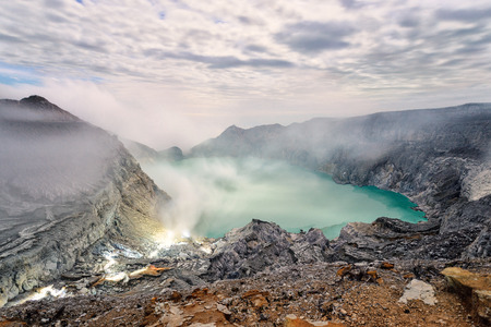 Sulfur mines,kawah ijen,indonesia.Sulfur mines view point.High angle shots.People look at sulfur mines.