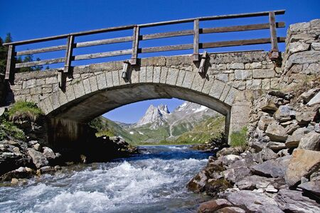 Arch bridge in the Val Ferret near Courmayeur Imagens