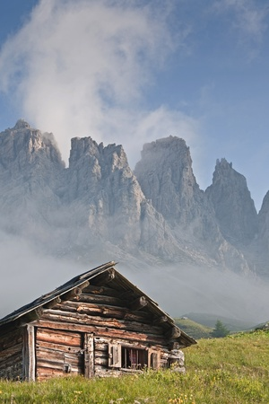 Hay huts before the peaks of the Puez Stock Photo