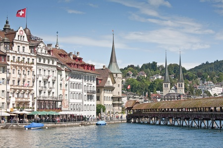 The Chapel Bridge with its water tower is the symbol of Swiss cantonal capital Lucerne photo