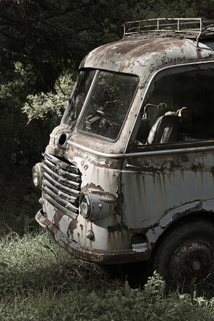 scrapped: Age scrapped van parked in a lonely forest Stock Photo