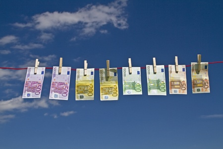 tax evasion: Banknotes on a clothesline