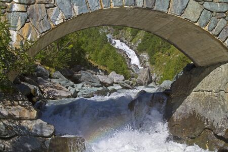 Bridge over the river Isel, which forms the famous and much visited Umbal waterfalls photo