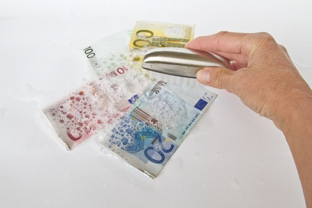 soapy water: Bills are washed in hot soapy water