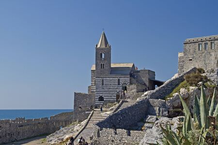 St Simon - the picturesque old church in the Gothic style, stands on the cliffs is the symbol of Portovenere Stock Photo