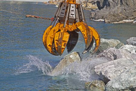 dredging tools: Dredging claw at their hard labor