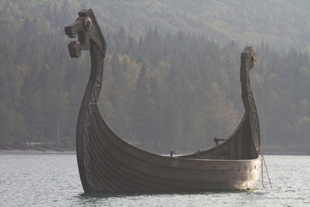 Viking ship in the Walchensee in backlight