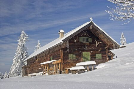 idyllic alpine hut in winter in Upper Bavaria photo
