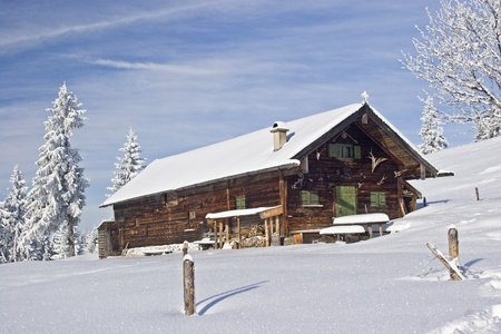 wasen steiner alm - idyllic mountain lodge in winter photo