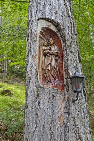 osttirol: Carved figure of Mary incorporated into a tree trunk