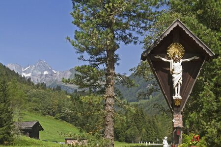 osttirol: Wooden cross and view at Grossglockner