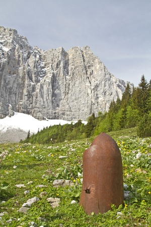 artillery shell: Remnant from the times of war far in a lonely valley in Karwendel Stock Photo