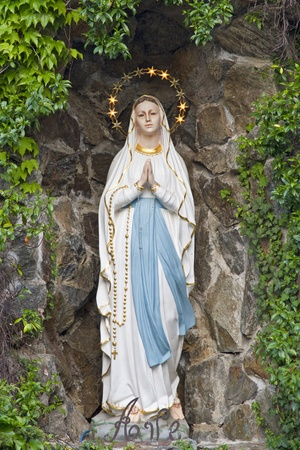 tatue of Mary in a grotto, a visitor attraction for believers